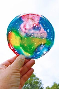 Create a sun catcher using slime. | 35 Science Experiments That Are Basically Magic