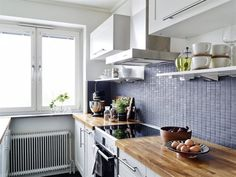 powder blue tiles for the kitchen (via Stadshem)