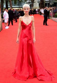 Andrea Riseborough somehow managed not to blend into the red carpet in a beautiful satin Ralph Lauren gown.