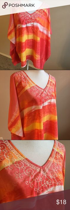Chico's NWOT l/XL flowy blouse Never worn beautiful blouse. Large / XL Very glory. Great for the beach or a cruise. Polyester. Measures 31 inches in length. Very generous in sizing. Chico's Tops Blouses