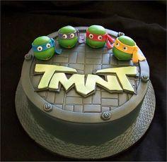 Ninja turtle birthday cake. Incorporates a cake pop! Nice!