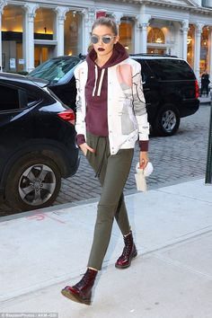 Casually cool: For her post-shoot look, the star wore a pair of forest green cropped sweat...
