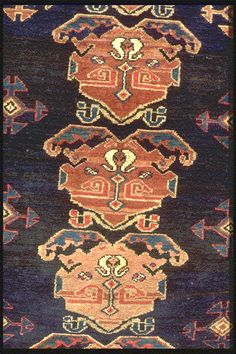 range of african mask spread on an indigo blue for this kurdi antique rug. 120 x 190.  henide@hotmail.com -  25 rue la Boétie  Paris 75008