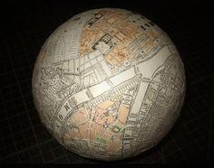 "Joe Ringenberg. The global city has no borders. 7"" globe, mixed media."