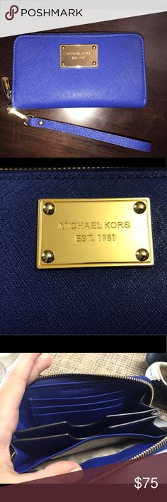 Electric Blue Saffiano Jet Set Michael Kors Wallet In perfect condition. Bought at Macy's no visible scratches. Pictures are of actual wallet/wristlet. Electric Blue with Gold accents Michael Kors Bags Clutches & Wristlets