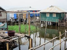 The bamboo houses of Ganvie village on Lake Nokoue near Cotonou, Benin, stand on teak stilts. The Tofinu people fled here in the 16th and 17th centuries to escape Dahomey slavers who were forbidden by their religion from traveling over water.