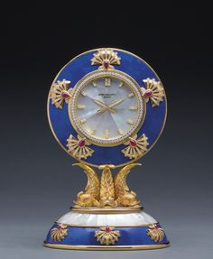 "PATEK PHILIPPE ""THE AUSPICIOUS CARP"" AN IMPORTANT AND VERY RARE YELLOW GOLD, DIAMOND, RUBY, MOTHER-OF-PEARL AND LAPIS LAZULI MANTEL CLOCK MADE IN 1990. Sotheby's"