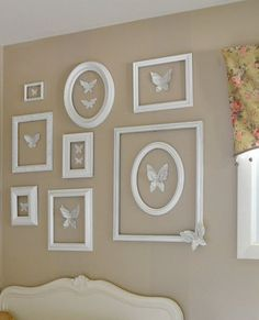 Love it ... white frames with paper butterflies cute from book pages. A sweet simple beautiful little girl room.: