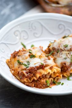 These Meaty Lasagna Roll-Ups are stuffed with a creamy ricotta mixture and a deliciously easy homemade meat sauce. A great make-ahead and freeze dish! Meat Lasagna Roll Ups Recipe, Meat Lasagna Rolls, Meaty Lasagna, Lasagna Recipe With Ricotta, Easy Lasagna Recipe, Pasta Lasagna, Homemade Speghetti Sauce, Homemade Meat Sauce, Homemade Spaghetti