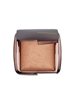 This baked powder is a highlighter and setting powder folded into one. When dusted all over the skin, it instantly offers a lit-from-within glow people will notice.Hourglass Ambient Lighting Powder in Radiant Light, $45, available at Sephora. #refinery29 http://www.refinery29.com/favorite-makeup-staples#slide-15