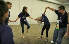 Students race to pass a hula hoop around each other while holding hands as they play cooperative games while participating in the Building Leaders And Strong Tomorrows Youth Group Games, Youth Activities, Team Building Activities, Activity Games, Family Games, Fun Games, Games For Kids, Party Games, Youth Groups