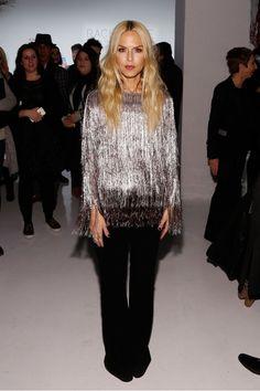 Rachel Zoe wears a metallic fringe top with black flared trousers