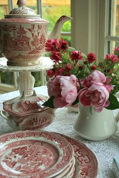 Dishes and peonies...perfect!!! Bebe'!!! Mix of Pink Transferware dishes!!!