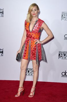 Elizabeth Banks: The actress made a statement in a multi-colored Peter Pilotto minidress and Melissa Kaye earrings.