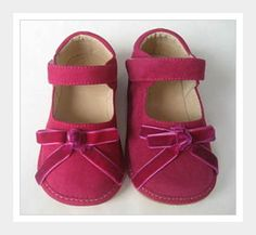 ASHLI - The Ashli is a velvety soft pink Mary Jane with an oh so feminine pink bow. It has a convenient velcro closure strap, roomy toe box, and nicely padded heel. So perfect for the little girl who loves all things pink!