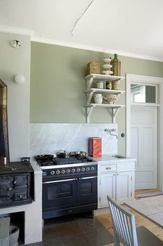 When kitchen appliances have a rustic patina from years of use, polish the look of the space with seafoam walls and a white marble backsplash.