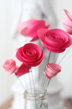 """Paper flowers are a creative and economic way to add color and cheer to your space. These particular flowers are a favorite because they don't come across as overly """"crafty"""" and you can make large quantities in hardly any time at all. As an added bonus, construction is simple and requires nothing more than scissors and quick-drying glue."""