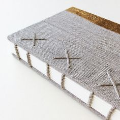 Natural Linen Coptic Bound Notebook with Minimalist Gold Decoration by paperiaarre