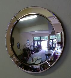 Art Deco period piece. Convex mirror with a pink tinge.
