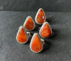Native American Sterling Silver and Natural Spiny Oyster Ring *Ring Sizes Vary. Please See Stone and Sizing Details Below* .925 Sterling Silver Natural Orange Spiny Oyster Handmade This .925 Sterling Sterling and pear cut Natural Orange Spiny Oyster is set within a handcrafted sterling silver Native American Rings, American Indian Jewelry, Western Rings, Silver Cuff, Sterling Silver, Southwestern Jewelry, Ring Sizes, Ring Ring, Boho Rings