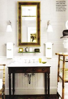 Suzie: Great bathroom  Love the dark chocolate sink vanity and mirror!  Double sconces and ...
