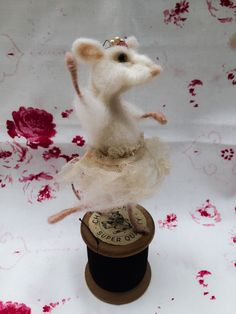 A personal favourite from my Etsy shop https://www.etsy.com/uk/listing/476772409/ooak-needle-felted-mouse-ballerina-on