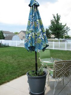 """DIY HEAVY DUTY patio umbrella """"stand"""" Needed a heavy duty patio umbrella stand so rather than buy one I bought the stuff to make one...needed: 1) potted planter dolly, 2) large pot, 3) PVC pipe, 4) 5 gallon bucket, 5) 75 lbs of no mix quikrete, 6) pea gravel, 7) sand, 8) potting soil, 9) plants, 10) patio umbrella (mine is 9')    Basically followed the description on this website: http://pennypinchingprovisions.blogspot.ca/2012/05/planter-umbrella-stand.html"""