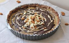 raw vegan chocolate drizzle tart. get in ma bellie!!  http://www.onegreenplanet.org/vegan-recipe/raw-chocolate-almond-caramel-crunch-tart/http://www.onegreenplanet.org/vegan-recipe/raw-chocolate-almond-caramel-crunch-tart/