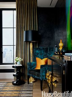 Reflective surfaces and jewel tones give a young woman's bedroom a dazzling richness.