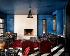 Love the peacock blue walls and black and white floors at the hotel saint cecilia in austin. image casey dunn