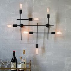 NEW! With its plated antique bronze finish and geometric grid shape, this wall sconce is both industrial and refined. Its large scale makes a statement, especially when paired with retro-style Edison bulbs.
