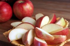 Soak apple slices for 5 minutes in a solution of 1 cup water and 1 tablespoon lemon juice. Drain and store in an airtight container in the refrigerator. Apples will stay crispy and fresh all week. Great for lunches and after school snacks. **Update: 2 Tbsp. per 1 c. works better.