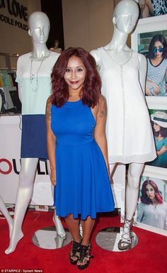 Proud mama! Snooki, real name Nicole Polizzi, introduced her latest additions to her fashion line Snooki Love  at Magic Market Week in Las Vegas on Tuesday