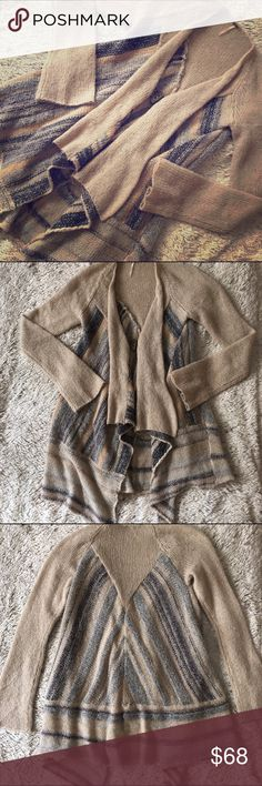 Free People Cozy Sweater-EUC Free People one button over sized cardigan sweater.  Waterfall/Shawl neck line with a large button closure.  Sleeves bell out slightly.  Colors are oatmeal, light blue and navy blue with some metallic threading throughout.  Gorgeous boho piece for Fall🍂🍁 Free People Sweaters Cardigans
