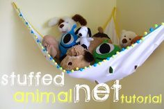 DIY stuffed animal net......this one is ugly but imagine leopard fabric or stripes with pink bow lining!