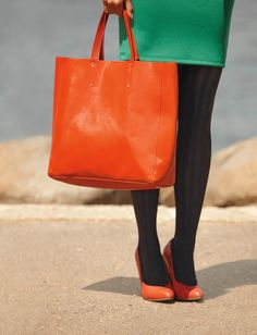 Orange bags are definitely in for fall, especially with classic black opaque tights