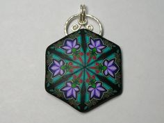 The detail you see in this kaleidoscope pattern pendant results from assembling the colored clays into patterns, forming a long cane. When the cane is sliced, it reveals the pattern inside. It hangs from a sterling silver hand made bail 1 and 3/4 of a inch. It is 1 and 1/4 inch across. The back is impressed with a floral pattern and has my little bee insignia on the back. A symbol I use to remind us that the impossible just may be possible!    see what I have in my other bead and button…