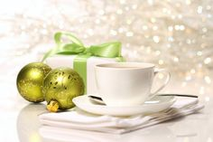 Coffee cups with two green ornaments