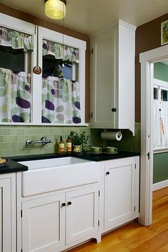 Soapstone counters, glass subway tile and apron front sink for the win. The big, apron-front sink is an attractive stand-in for old-fashioned enameled sinks. Photo by Jaimee Itagaki. New Kitchen, Vintage Kitchen, Kitchen Ideas, Green Kitchen, 1920s Kitchen, Kitchen Pics, Kitchen Redo, Kitchen Inspiration, Design Inspiration