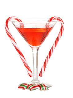 Candy Cane Cosmo (2 oz. Devotion Vodka Perfect Cosmo  1 oz. peppermint schnapps  Sugar free cranberry juice  Garnish: candy cane)