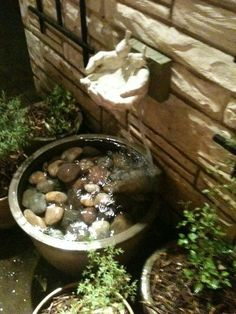 Clasped hands dripping fountain | Container water fountain ideas