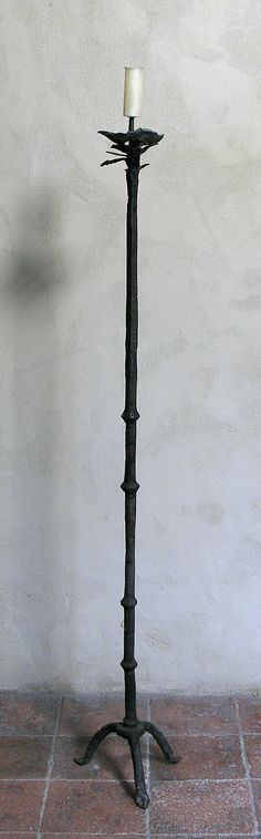 Candlestick Date: 15th century Culture: European Medium: Metalwork- Iron Dimensions: Overall: 61 1/4 x 11 1/4 x 8 3/4 in. (155.6 x 28.6 x 22.2 cm) Classification: Metalwork