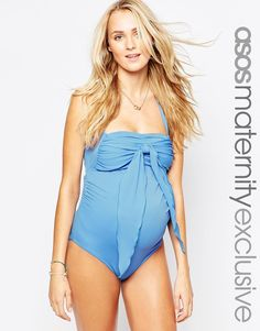 Maternity swimsuit exclusive to the ASOS Maternity collection Stretch swim fabric Halter neckline Ruched design Front tie bow detail Keyhole back with clip fastening Flattering cut to reverse Designed to fit through all stages of pregnancy Hand wash 80% Polyamide, 20% Elastane