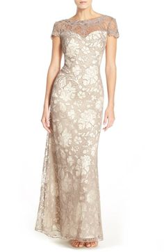 Free shipping and returns on Tadashi Shoji 'Jacky' Illusion Embroidered Gown at Nordstrom.com. A romantic illusion yoke frames the sweetheart neck and low scooped back of a statuesque evening gown traced in impeccable embroidery that takes on the classic look of lace.