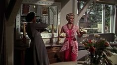 Lana Turner was impeccably dressed in Imitation of Life.  I'd wear this little number now