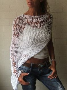 Sexy fishnet asymmetric top over tank worn with jeans