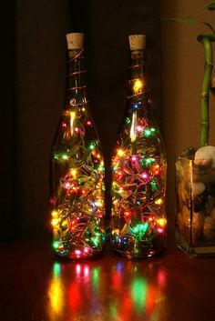 Wine Bottle Lights - Christmas lights are'nt just for Christmas anymore. Lighted Wine Bottles, Bottle Lights, Bottle Lamps, Glass Bottles, Wine Bottle Candles, Champagne Bottles, Wine Glass, Holiday Crafts, Holiday Fun