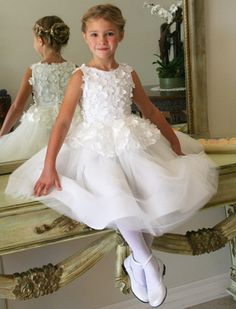 Fairy Floral Applique Girls Dress white flower applique bodice and peplum with a tulle skirt.