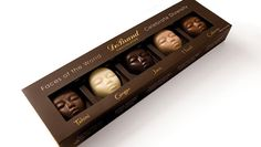 """""""Faces of the World (5pc.) Assorted Box of 5 from DeBrand Fine Chocolates"""" -- Beautiful chocolate faces represent one each of the following pieces: Tahini; Ginger; Java; Hazel; Caliente."""