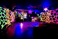 This is how you decorate with UV for a Blacklight party! Torn and stretched material?